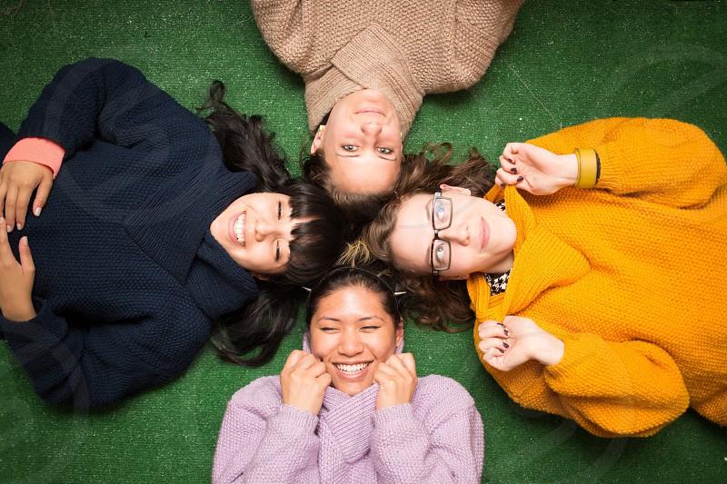4 women lying down smiling photo