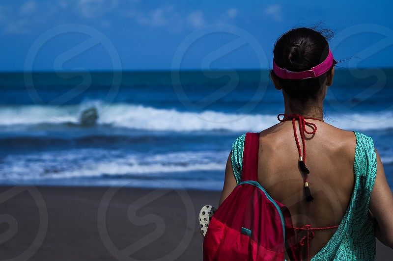 Peace; inner peace; serenity; beach; bali; indonesia; petitenget; contemplating; woman; standing; pray; peaceful photo