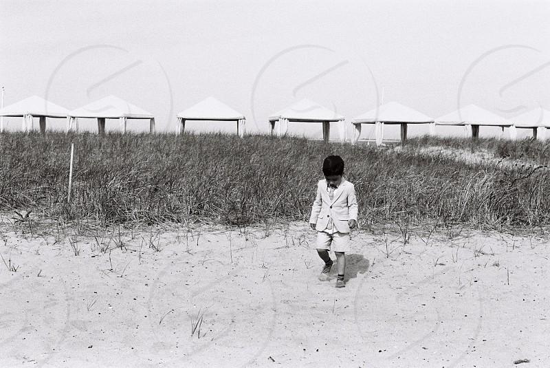 A boy on the beach photo