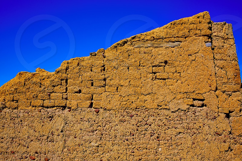 The way of saint James adobe mud walls at Palencia Spain photo