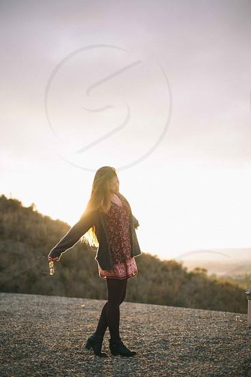 woman in black leggings walking on sun rise photo