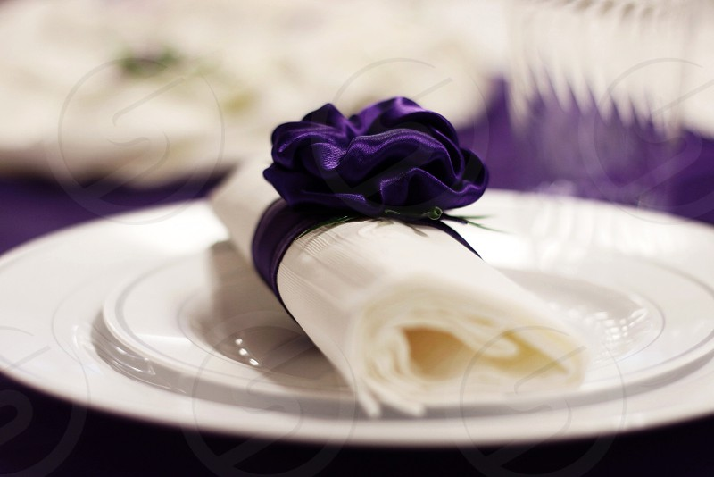 white table napkin on plate photo