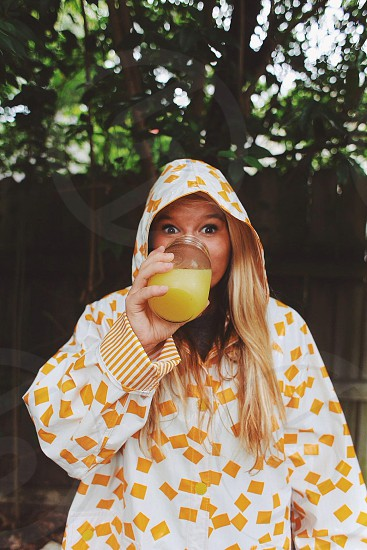 woman wearing white hoodie with yellow squares print photo