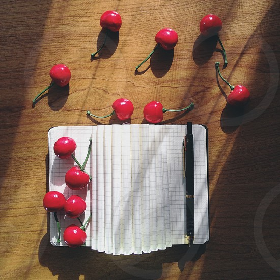 Cherry pen write book notebook note table Industry district urban area great sun sunshine nice beautiful amazing white photos photography photo foto awesome cute awesome best picoftheday photooftheday nature bright color colorful vsco vscobest photo