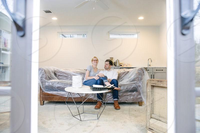 Young couple having fun renovating their home. photo