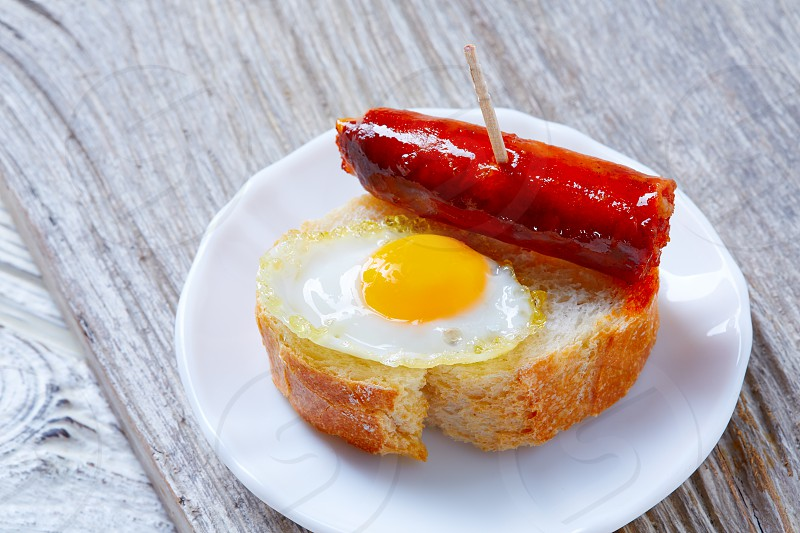 pinchos pintxos chistorra with quail egg tapas from Spain sausage food photo