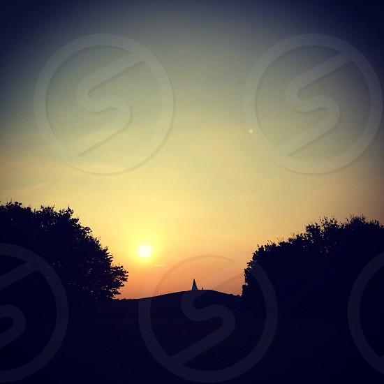 Landscape hill sunset sculpture Mikton Keynes Campbell Park trees photo
