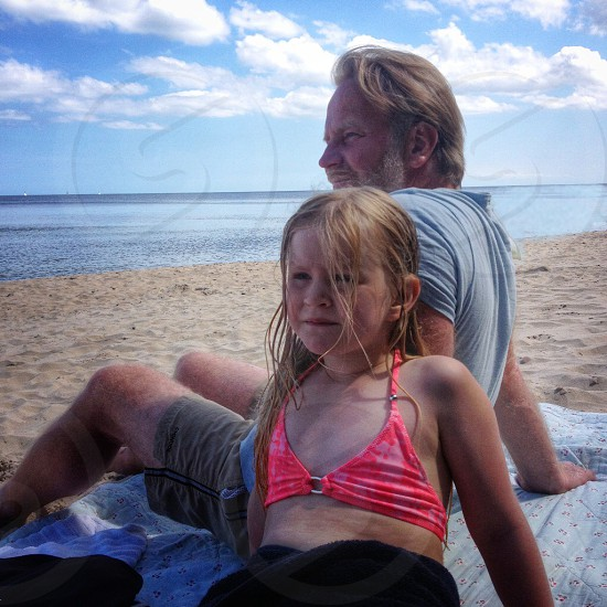 Relaxing beach sea sand father daughter child kid photo
