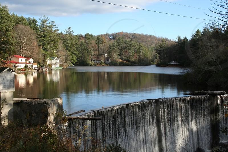Waterfall over manmade dam photo