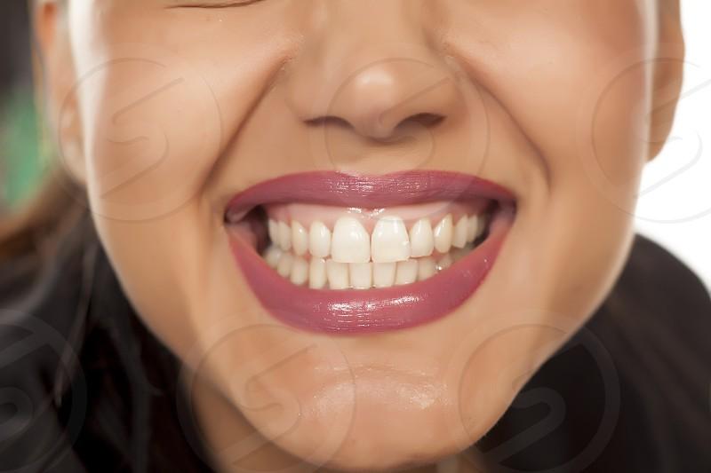 happy woman shows her beautiful white teeth photo
