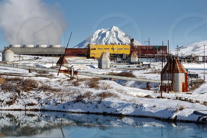 KAMCHATKA PENINSULA RUSSIA - Oct 22 2017: Winter view on Mutnovskaya Geothermal Power Station (Mutnovskaya GeoPP-1) Geotherm JSC (PJSC RusHydro) using geothermal energy to produce electricity. photo