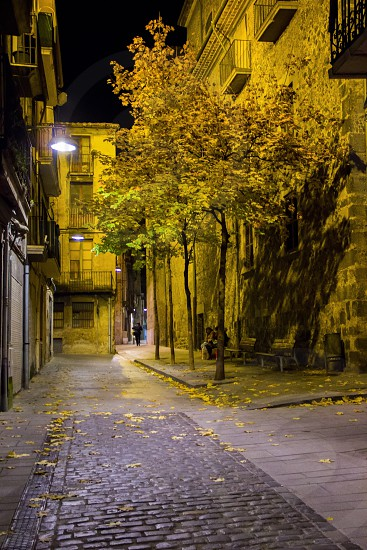 A small street of an old Spanish town on an autumn night. photo