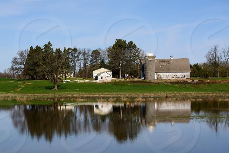 Barn reflection in field full of water.   photo