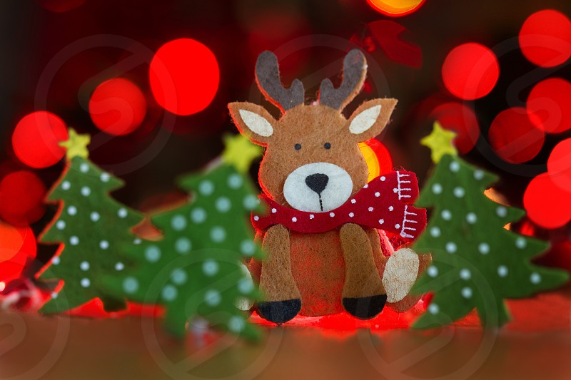 Reindeer Christmas decoration on red background photo