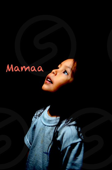 girl wearing blue crew-neck t-shirt with mamaa text overlay photo