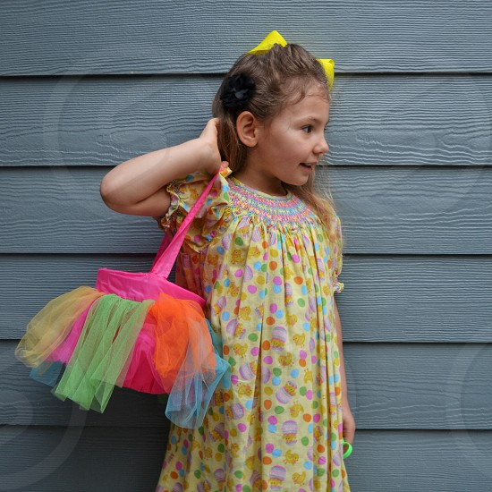 Easter colorful dress eggs basket bright colors springtime yellow bow beautiful girl photo