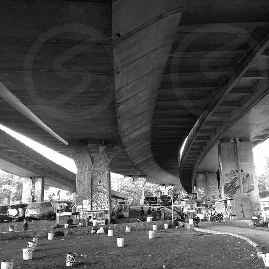 grayscale photography of flyover during daytime photo