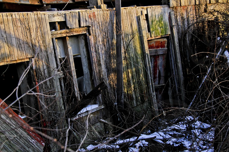 Old abandoned barn windows at golden hour photo
