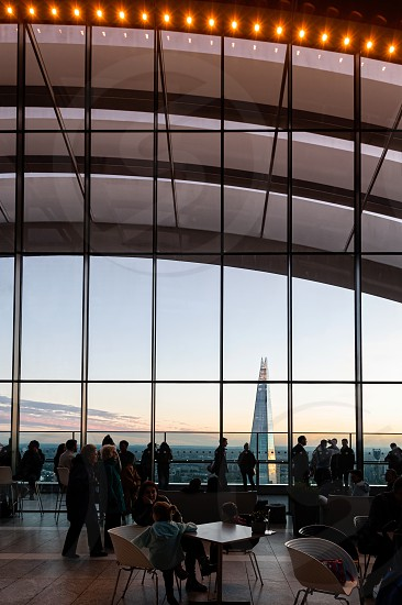Visitors enjoiying view from Sky Garden Terraces at south London with Shard skyscraper. Second tallest in Europe. photo