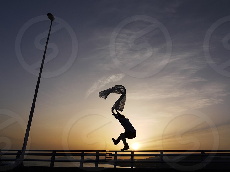 man jumping silhouette photo