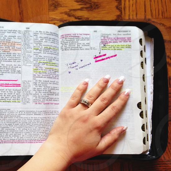 """Proverbs 31 mentions """"hands"""" seven times. My hand on my Bible my source of strength and encouragement.  photo"""