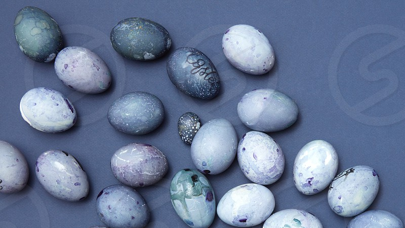 Pattern of easter eggs on blue background flat lay photo