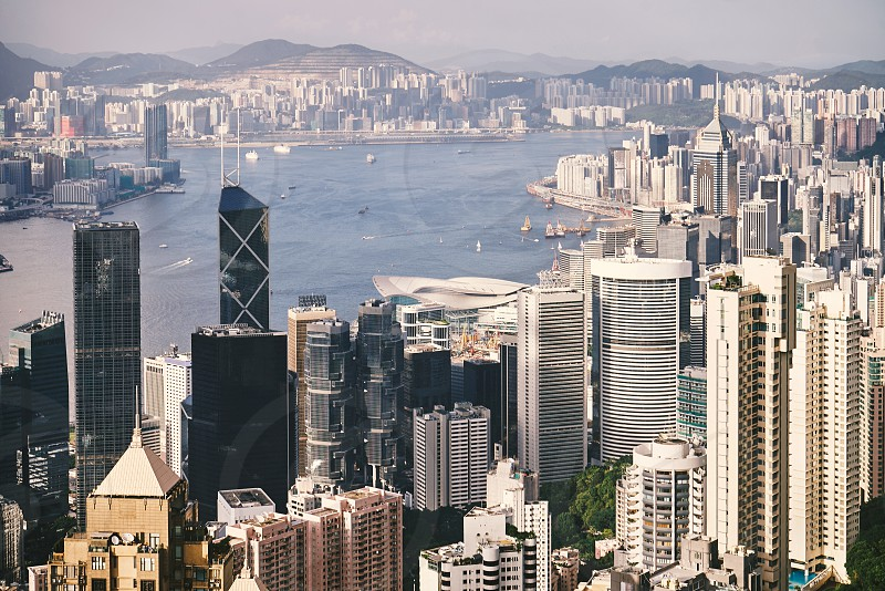 The panoramic skyscrapers cityscape view of beautiful building in city downtown from Victoria peak of Hong Kong photo