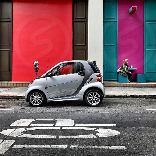 Silver Smartcar colorful wall.  photo