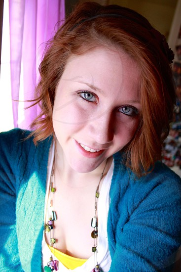 Blue eyes red hair colorful smile photo