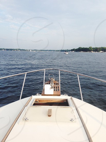 white speed boat on body of water photo