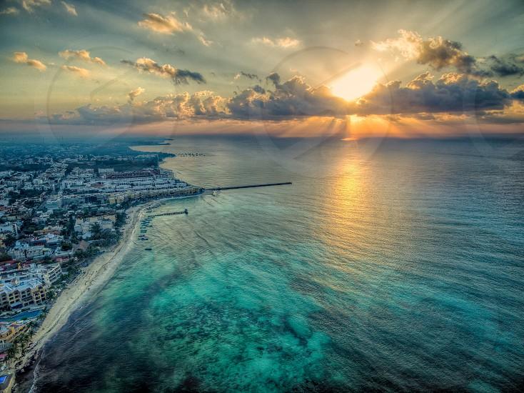 cityscpe beside sea sunrise photo