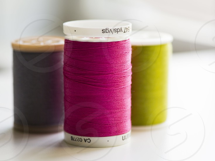 pink purple and yellow thread rolls photo