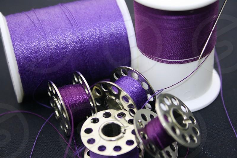 Needle thread bobbin spool purple sew photo
