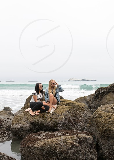 girls by the beach  photo