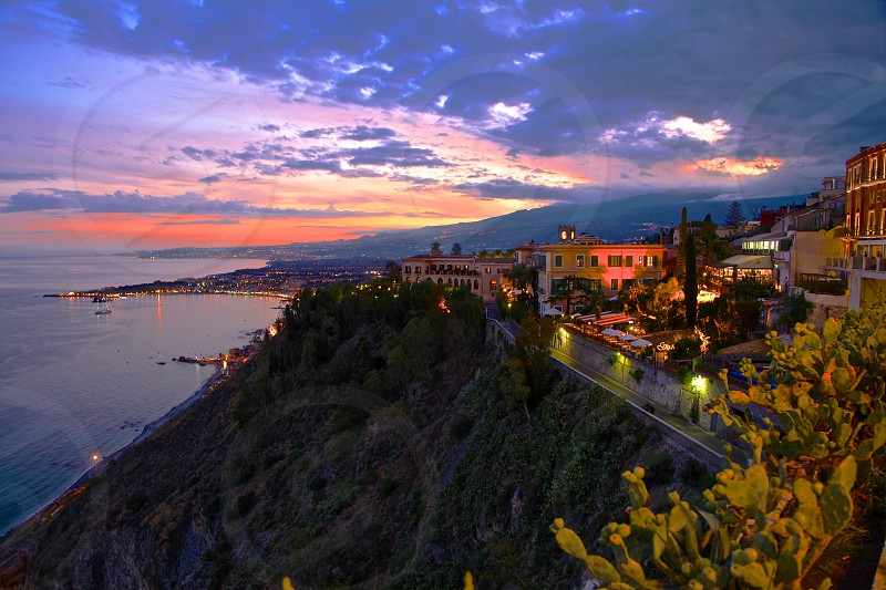 Italy evening sea clouds building photo