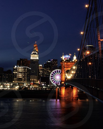 Cityscape night lights bridge Ferris wheel city night life city lights photo