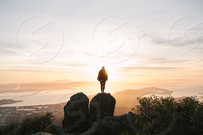 person on top of a big rock photo