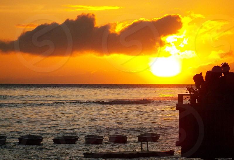 blue sea during a sun set photo