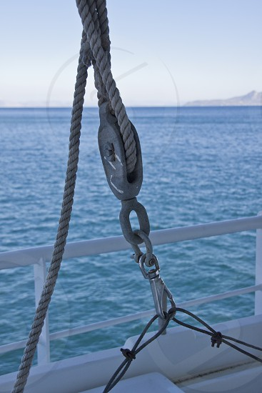 Rope and pulley on ferry boat in Greece photo