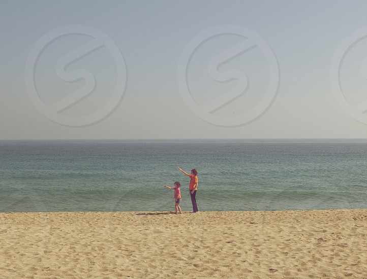 woman and girl at the seashore photo