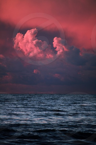 Pink clouds over the sea art sunset photo