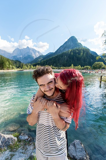 Happy couple in love by the lake. photo