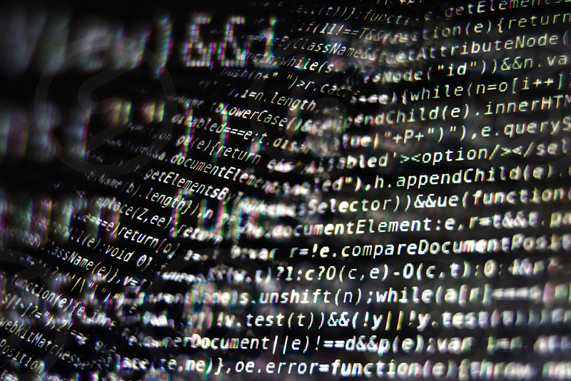 White Program Source Code Segments on Black Screen Macro Closeup photo