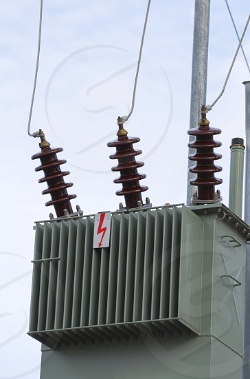 Olive Color Electric Transformer Closeup with Clear Sky photo