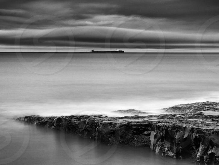 Long exposure showing the Farne Islands off the coast of Northumberland England UK photo