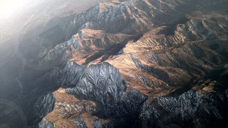 Flying high over the mountains.  photo