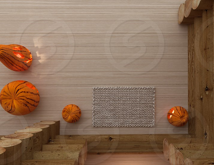 four pumpkin lamps on brown surface photo