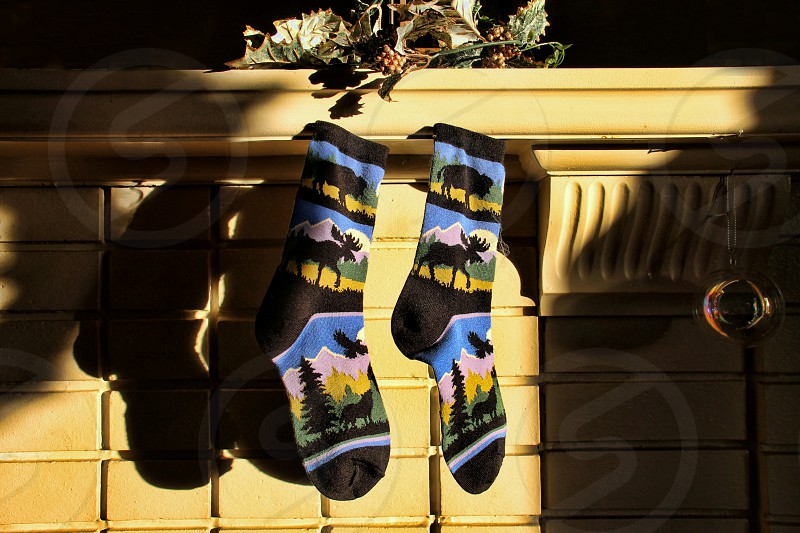 Colorful socks hanging on the mantle for Christmas photo