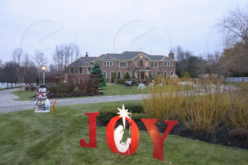 joy designed outdoor decor and snowman decor outside house photo