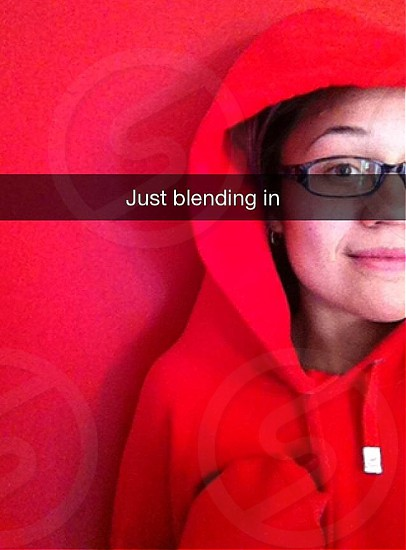 woman in red zip up hoodie just blending in photo photo